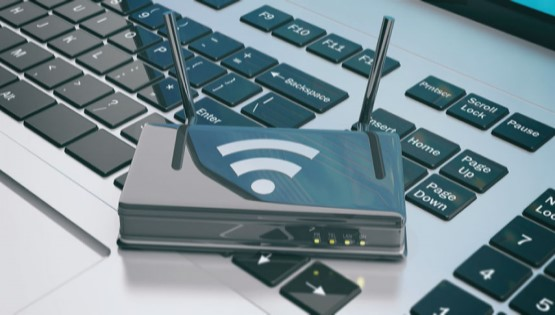 Broadband_Router_On_Computer_Keyboard.jpg